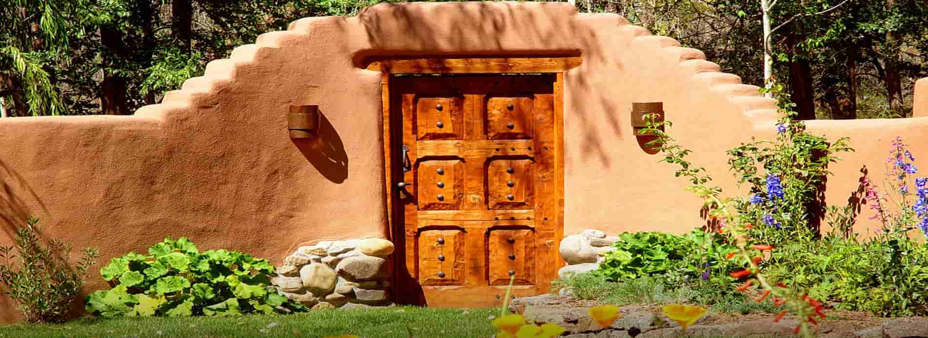 Taos_Hacienda_yard_door_1903x694-min-2-min
